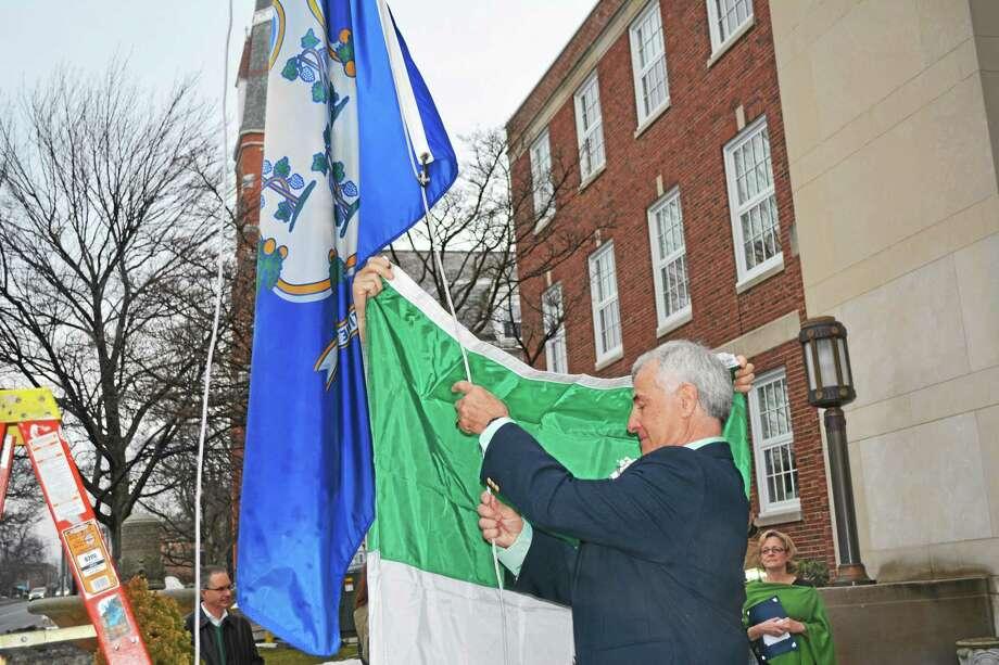 Lord Mayor Francis DuCotey raised the Irish flag outside City Hall on Tuesday morning to celebrate St. Patrick's Day. Photo: Amanda Webster — The Register Citizen