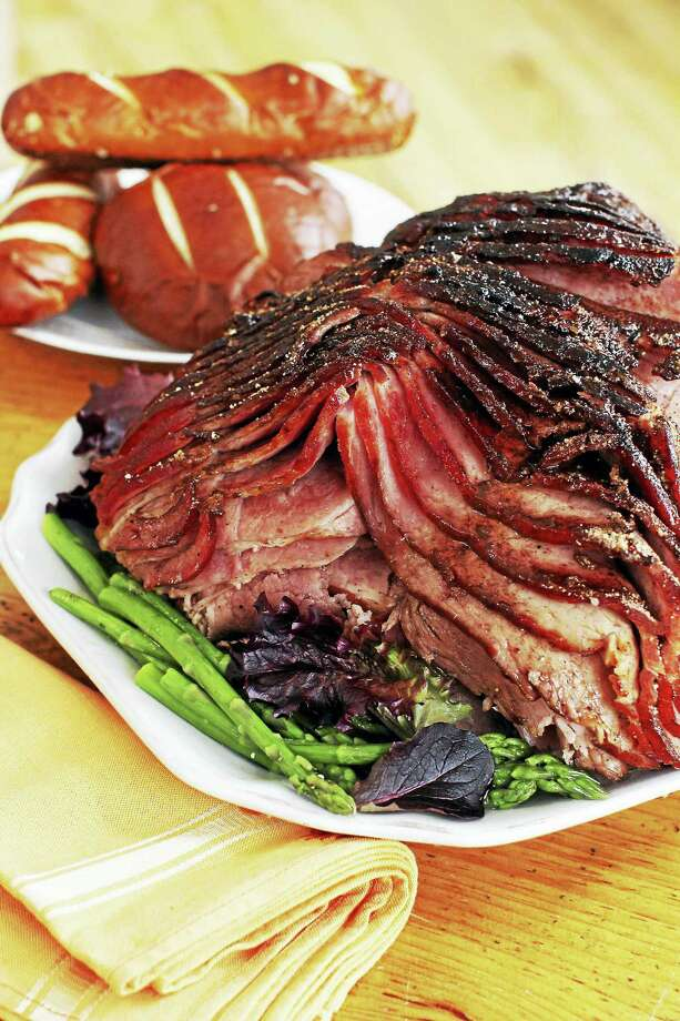 For a better way to glaze your ham, try a dry spice rub that caramelizes into a rich sweet and spicy glaze. Photo: Matthew Mead — The Associated Press  / AP