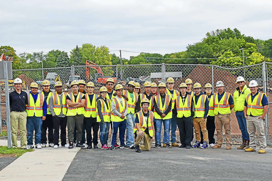 Contributed photoO&G Industries joined students at Platt Tech for its fourth PlattBuilds project at the school in Meriden. Photo: Journal Register Co.