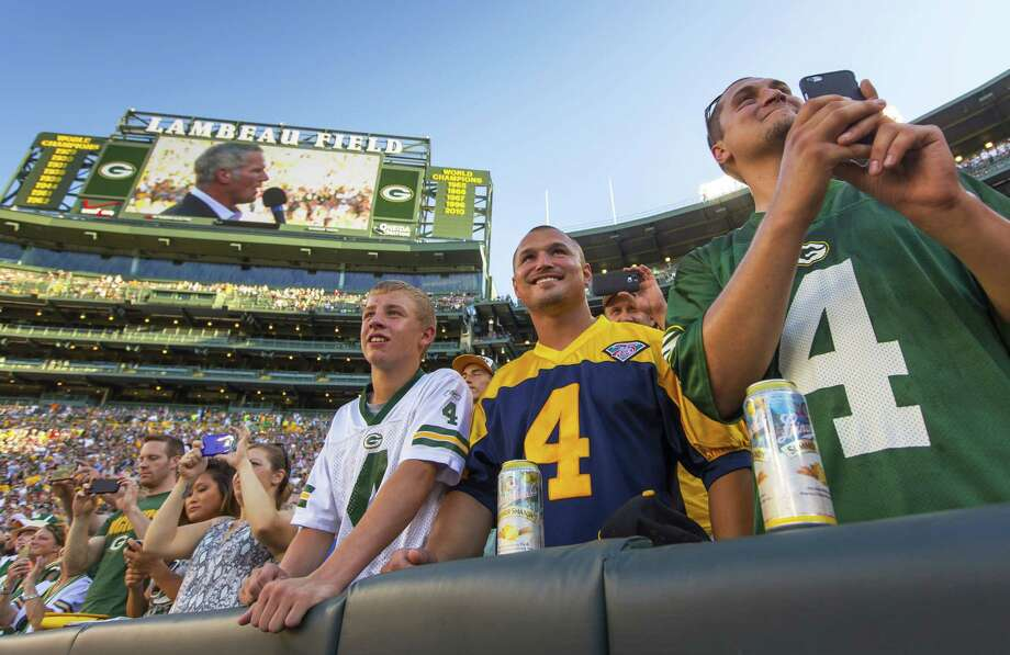 Fans watch former Green Bay Packers quarterback Brett Favre give a speech at Lambeau Field prior to his induction to the Packers Hall of Fame on Saturday. Photo: Mike Roemer — The Associated Press  / FR155603 AP