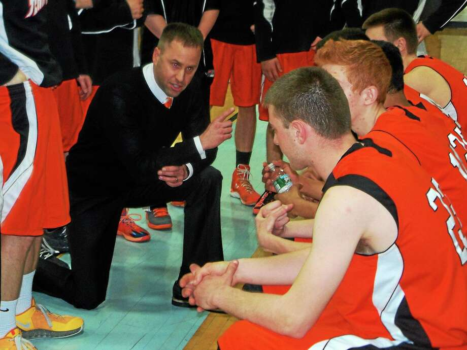 Terryville coach Mark Fowler urges his players on in their 55-41 Class S boys basketball quarterfinal loss to SMSA Hartford Monday night. Photo: Peter Wallace — Register Citizen