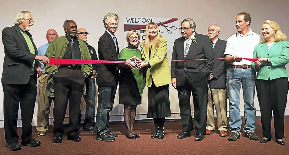 Joined by Torrington Mayor Elinor Carbone, center, Teresa Sullivan, right of the mayor, and John Sullivan, left of the mayor, cut the ribbon opening the new home of the Connecticut Academy For The Arts' (CAFTA's) newly purchased location at 100 Prospect St. Photo: Contributed Photo - Teresa Sullivan