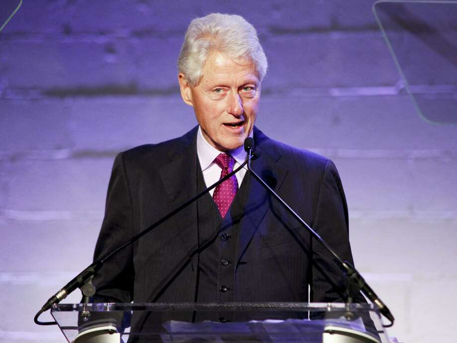 """FILE - In a Thursday, Oct. 6, 2016 file photo, former President Bill Clinton attends the Jon Bon Jovi Soul Foundation (JBJSF) benefit gala, celebrating ten years of combating hunger and homelessness, at The Garage, in New York. Donald Trump has accused the former president of """"rape,"""" Hillary Clinton of being an """"enabler"""" and threatened to shift those issues from his Twitter feed to the presidential debate stage on Sunday, Oct. 9, 2016.  (Photo by Andy Kropa/Invision/AP, File) Photo: AP / Invision"""