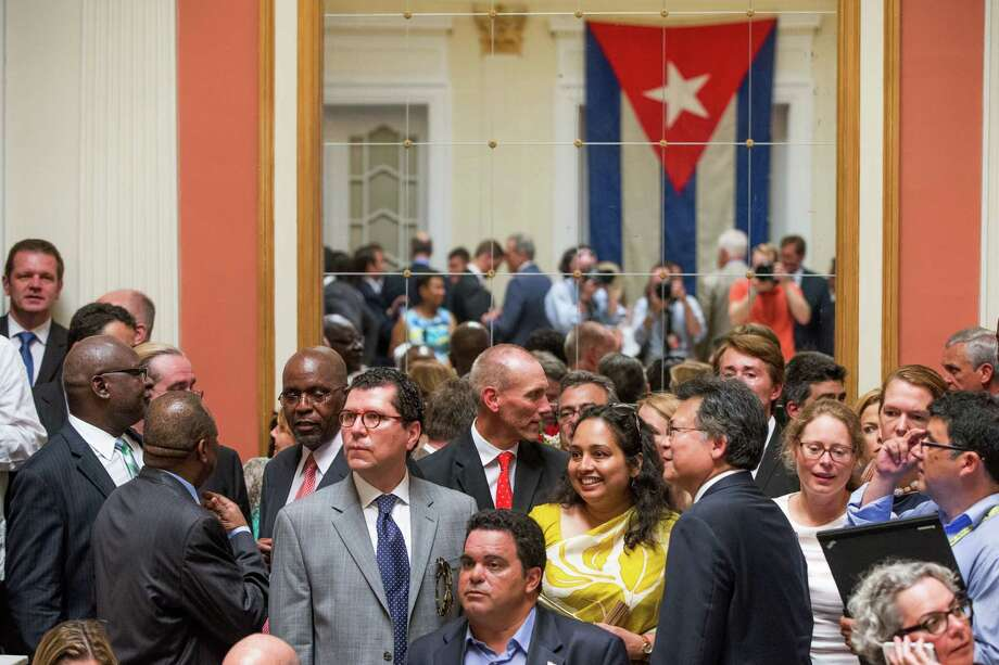 Visitors mingling in the newly reopened Cuban embassy in Washington on Monday, July 20, 2015. Cuba's blue, red and white-starred flag was hoisted Monday at the country's embassy in Washington in a symbolic move signaling the start of a new post-Cold War era in U.S.-Cuba relations. Photo: AP Photo/Andrew Harnik, Pool  / AP POOL