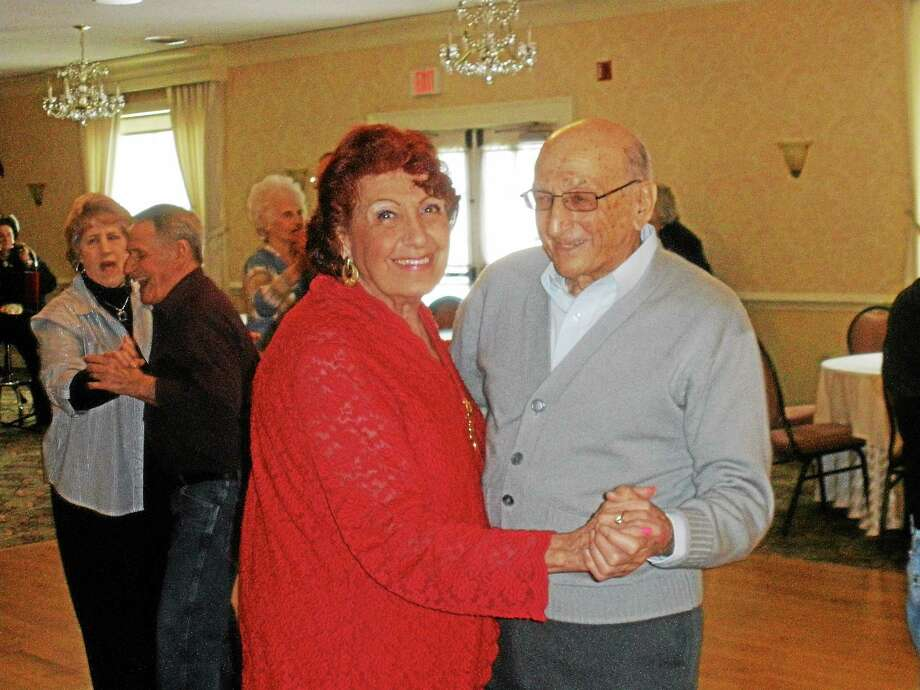 Irene Summa of Torrington dancing with Guido Sebben at Cornucopia Banquet Hall on Sunday. Photo: Stephen Underwood — Special To The Register Citizen
