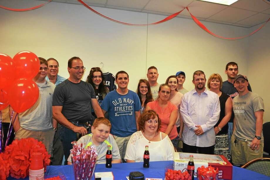 AMANDA WEBSTER — THE REGISTER CITIZEN A party to celebrate Justin Wheeler, standing, center, was held at  Subaru of Torrington on Monday. Justin and his family will be visiting San Francisco with the help of Connecticut's Make a Wish Foundation. Photo: Journal Register Co.