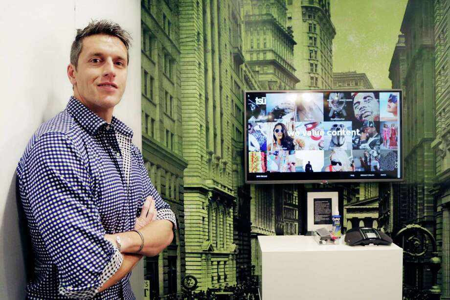 Sebastian Sobczak, CEO of Tsu.co, poses in his company's New York office. Tsu.co is winning converts to its social network by paying them for their posts. Photo: Mark Lennihan — The Associated Press  / AP