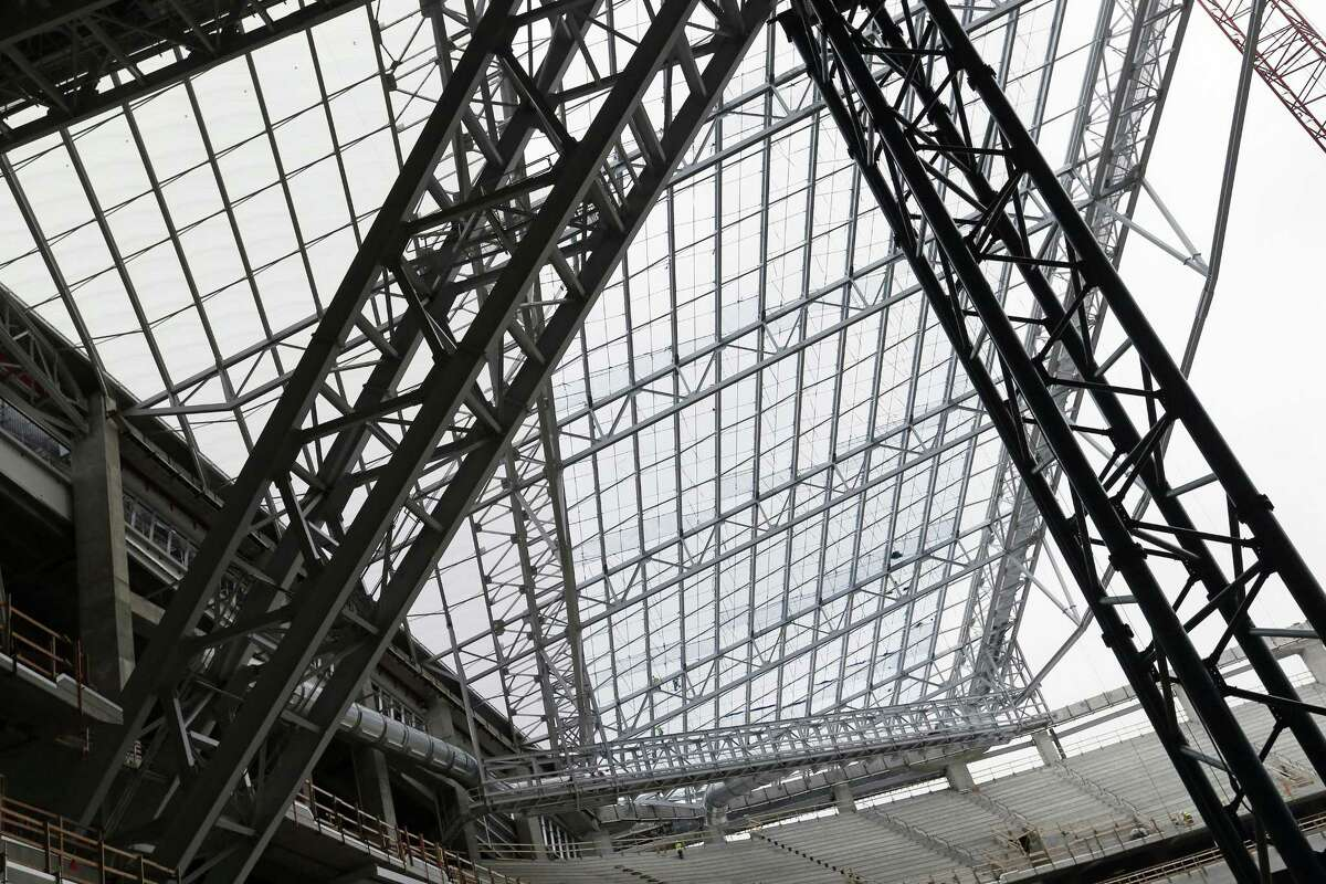 In this photo taken Thursday, installed see-through, lightweight EFTE roof panels are visible, upper left triangular section, as the roof takes shape at the new Minnesota Vikings NFL football stadium.