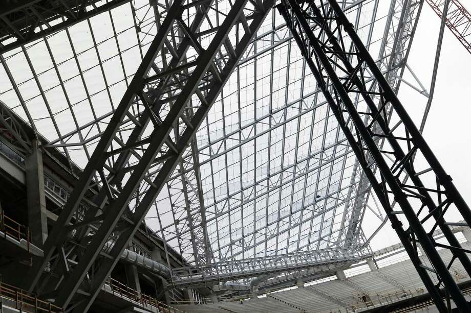 In this photo taken Thursday, installed see-through, lightweight EFTE roof panels are visible, upper left triangular section, as the roof takes shape at the new Minnesota Vikings NFL football stadium. Photo: The Associated Press  / AP
