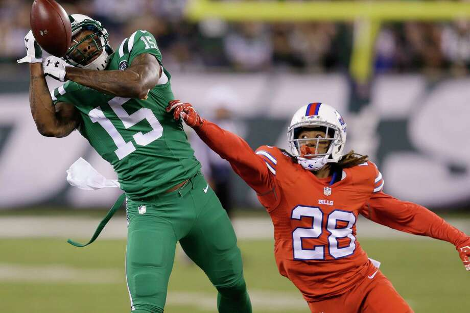 New York Jets receiver Brandon Marshall is unable to make a catch as Buffalo Bills cornerback Ronald Darby (28) defends during Thursday's game in East Rutherford, N.J. Photo: Seth Wenig — The Associated Press  / AP
