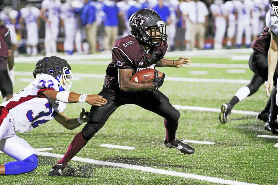 Torrington's Jermaine Reese caught one of just four passes by both teams in Friday's game at the Robert H. Frost Sports Complex. Photo: Photo By Marianne Killackey  / 2015