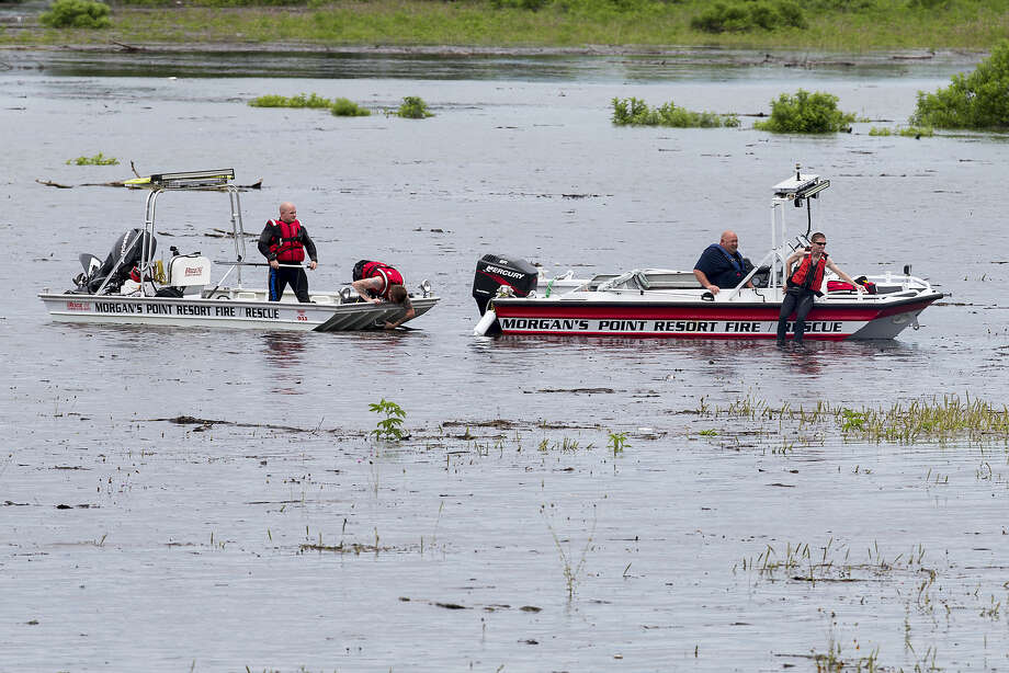 Morgan's Point Resort Fire and Rescue works on Lake Belton near the scene of an accident at Fort Hood at Owl Creek Park near Gatesville, Texas, on Thursday, June 2, 2016. Photo: Michael Miller — The Temple Daily Telegram Via AP   / All Rights Reserved