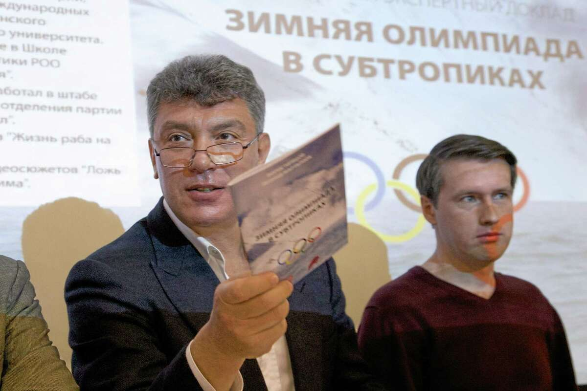 Boris Nemtsov, a former Russian deputy prime minister and opposition leader, presented a report claiming widespread corruption during preparations for the 2014 Winter Games in Sochi, at a news conference in Moscow, Russia, in this May 30, 2013 file photo.