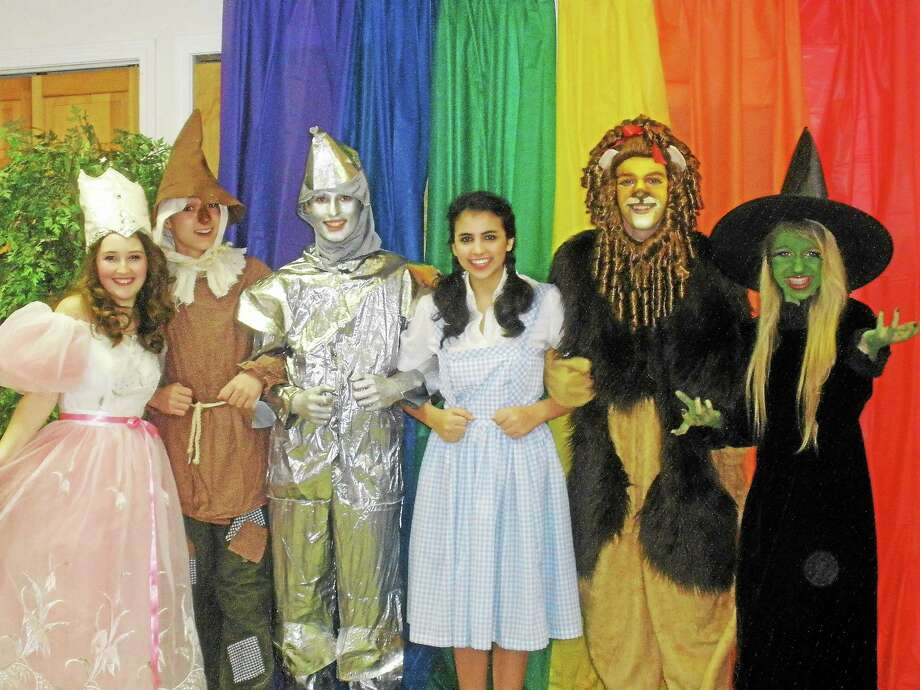 """Students cast in the """"Wizard of OZ"""" from left, Jenna Noell as Glinda, Duncan DeMichiel as Scarecrow, Anthony Rivera as Tin Man, Mia Famularo as Dorothy, Jacob Taylor as Lion, and Avery Naidorf as the Wicked Witch. Photo: Stephen Underwood — Special To The Register Citizen"""