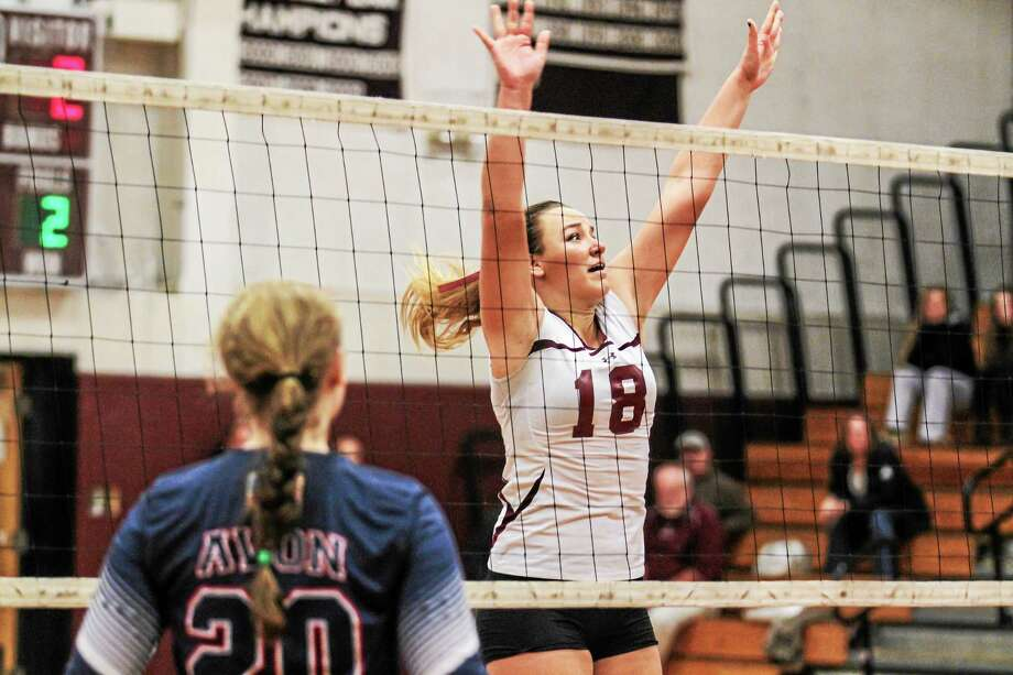 Torrington's Caitlyn Cornish attempts to make a block against Avon. Photo: Marianne Killackey — Special To Register Citizen  / 2015
