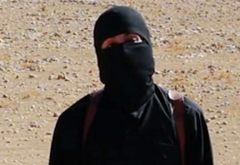 """This still image from undated video released by Islamic State militants on Oct. 3, 2014, purports to show the militant known as Jihadi John. A U.S. drone strike targeted a vehicle in Syria believed to be transporting the masked Islamic State militant known as """"Jihadi John"""" on Thursday, Nov. 12, 2015, according to American officials. Whether the strike killed the British man who appears in several videos depicting the beheadings of Western hostages was not known, officials said. Photo: AP Photo/File  / AP"""