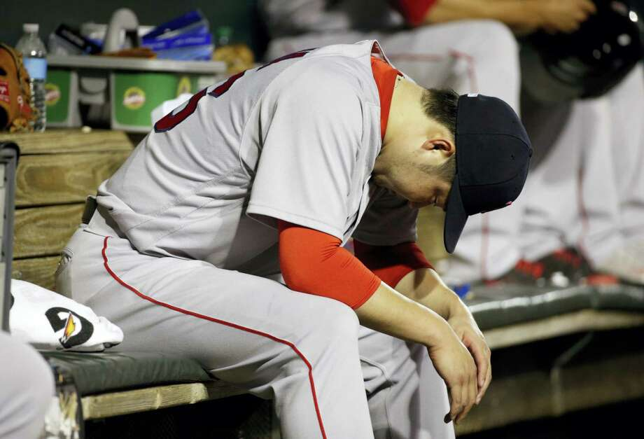 Junichi Tazawa sits in the dugout after being removed during the eighth inning on Thursday. Photo: Patrick Semansky — The Associated Press  / Copyright 2016 The Associated Press. All rights reserved. This material may not be published, broadcast, rewritten or redistribu