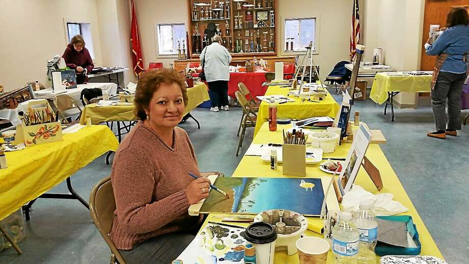 Evelina Gervickas of Plymouth participates in an all-day seminar on decorative painting in New Hartford. Art instructor Anne Hunter taught 12 participants to paint with acrylics on wood panels the rendering of a blue heron on Saturday. Photo: N.F. Ambery — Special To The Register Citizen