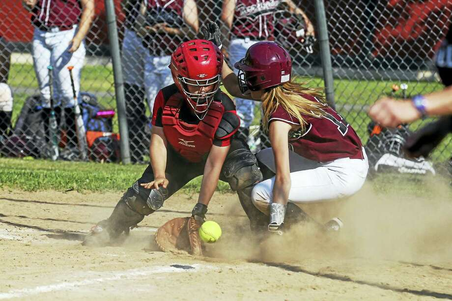 Torrington's Alyssa Dowd beats the throw at home in the Red Raiders' Class L quarterfinal win over Pomperaug Thursday at Torrington High School. Photo: Photo By Marianne Killackey  / 2015