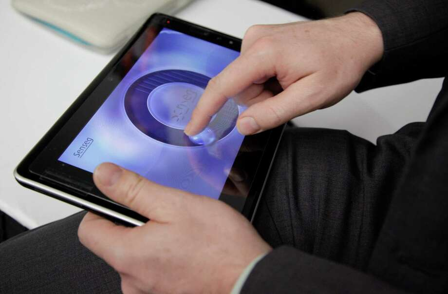 A tablet made my Senseg is demonstrated at the 2012 International CES tradeshow in Las Vegas. The tablet gives the user tactile feedback at the touch of the screen. Photo: AP File Photo  / AP