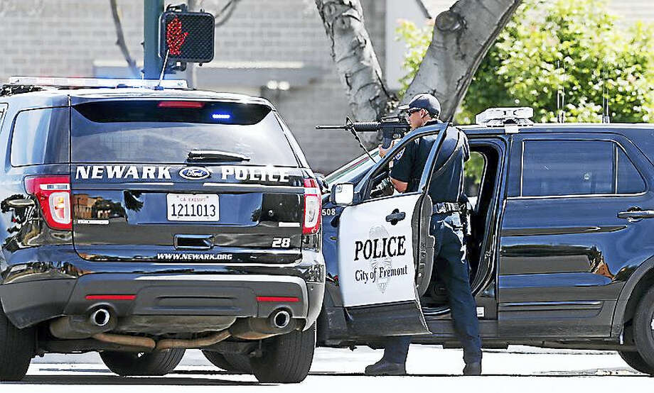 Aric Crabb — Bay Area News Group Police officers are photographed along Washington Blvd. on June 1, 2016 in Fremont, Calif. Photo: ARIC CRABB / BAY AREA NEWS GROUP