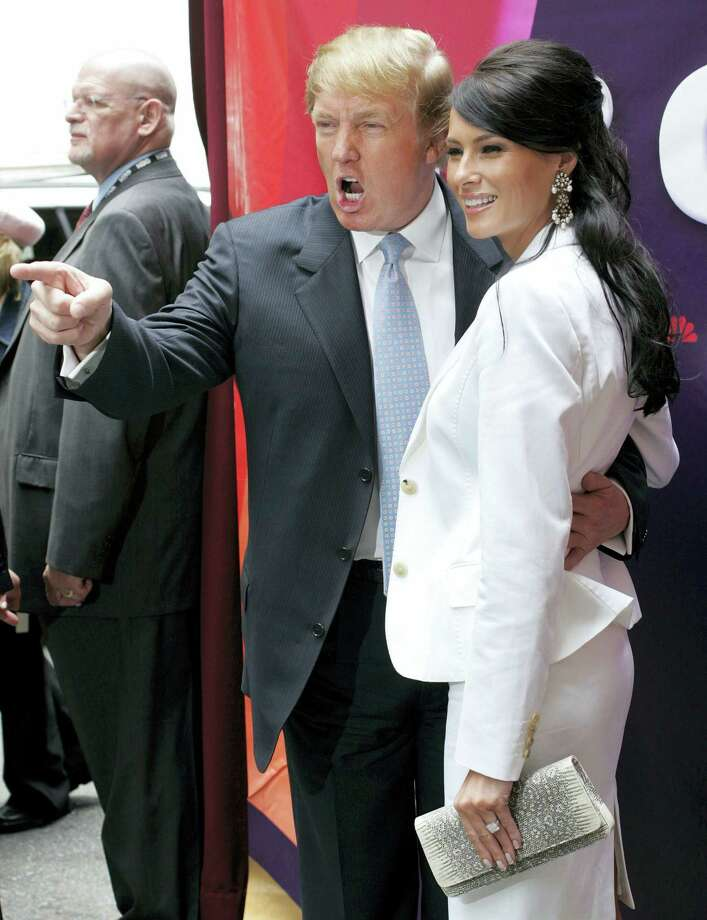 """In this Monday, May 17, 2004, file photo, Donald Trump, center, star of the television show """"The Apprentice,"""" and his then fiancee, Melania Knauss, right, arrive for NBC's presentation of its fall season to advertisers at Radio City Music Hall in New York. Randal Pinkett, who won the program in December 2005 and who has recently criticized Trump during his 2016 run for president, said he remembered the real estate mogul talking about which contestants he wanted to sleep with, even though Trump had married Melania, a former model, earlier that year: """"He was like 'Isn't she hot, check her out,' kind of gawking, something to the effect of 'I'd like to hit that.'"""" Photo: AP Photo/John Marshall Mantel   / AP2004"""