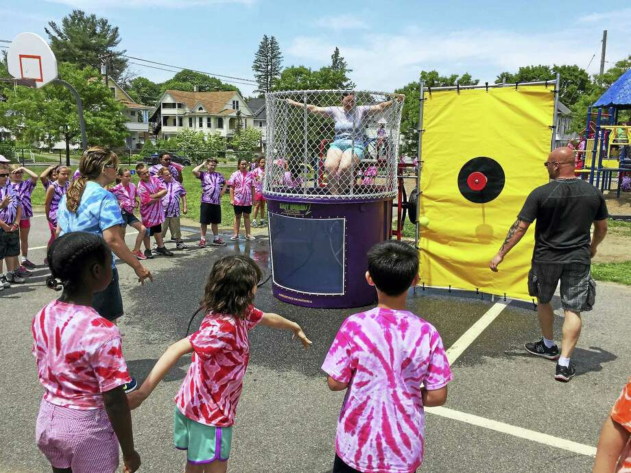 PHOTO BY BEN LAMBERT  Southwest School students enjoy field day Thursday, an annual celebration marking the near-end of the school year. A dunk tank game with faculty members was a popular part of the day. Photo: Journal Register Co.
