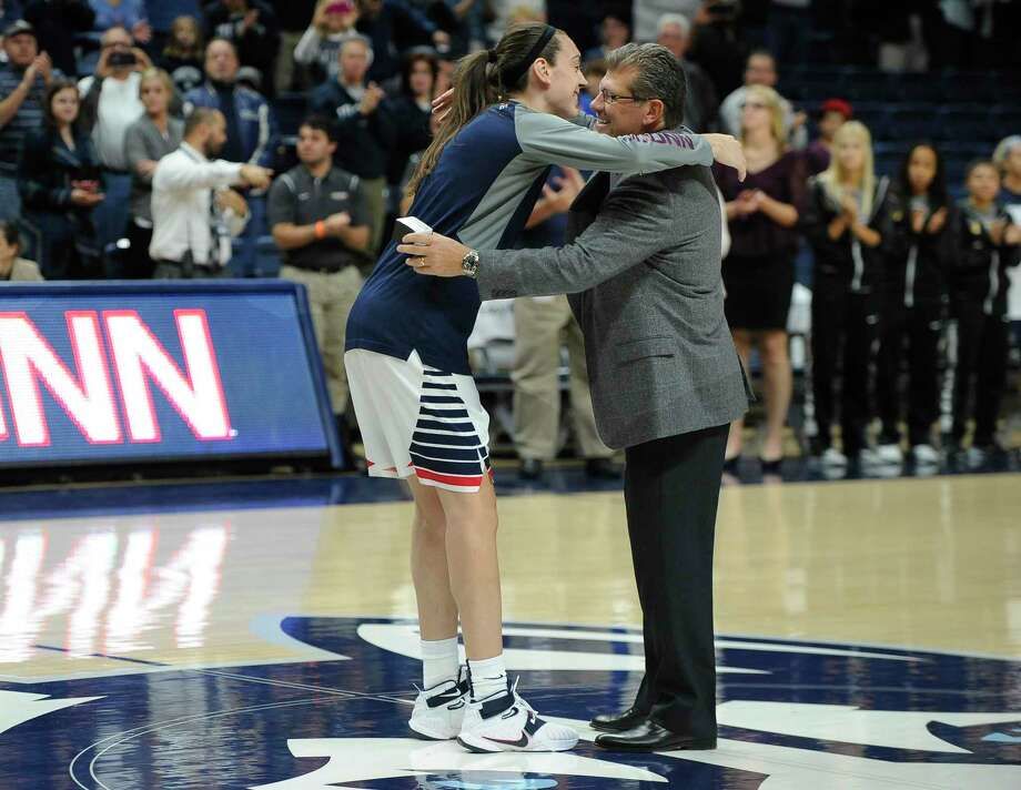 UConn coach Geno Auriemma hugs senior Breanna Stewart during a ceremony in which the Huskies received rings for their 2015 national championship prior to an exhibition game against Vanguard on Sunday in Storrs. Photo: Jessica Hill — The Associated Press  / FR125654 AP