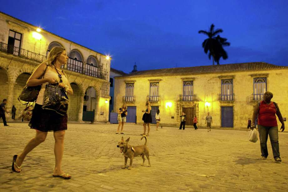A dog mingles with tourists and Cubans in Cathedral Square in Old Havana, Cuba on March 18, 2016. U.S. President Barack Obama will visit the communist island on March 20. During his three-day trip, the first to the country by a sitting U.S. president in nearly 90 years, he will meet with President Raul Castro at the Palace of the Revolution and attend an exhibition baseball game. Photo: AP Photo/Rebecca Blackwell  / AP