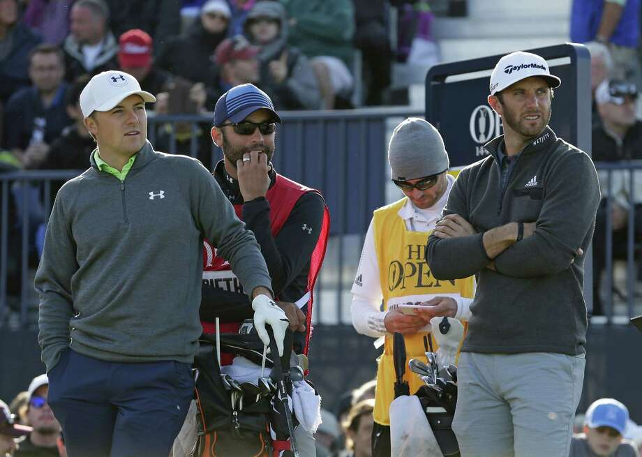 Jordan Spieth, left, and Dustin Johnson, right, wait to tee off from the 17th hole during the second round of the British Open Saturday. Photo: David J. Phillip — The Associated Press  / AP