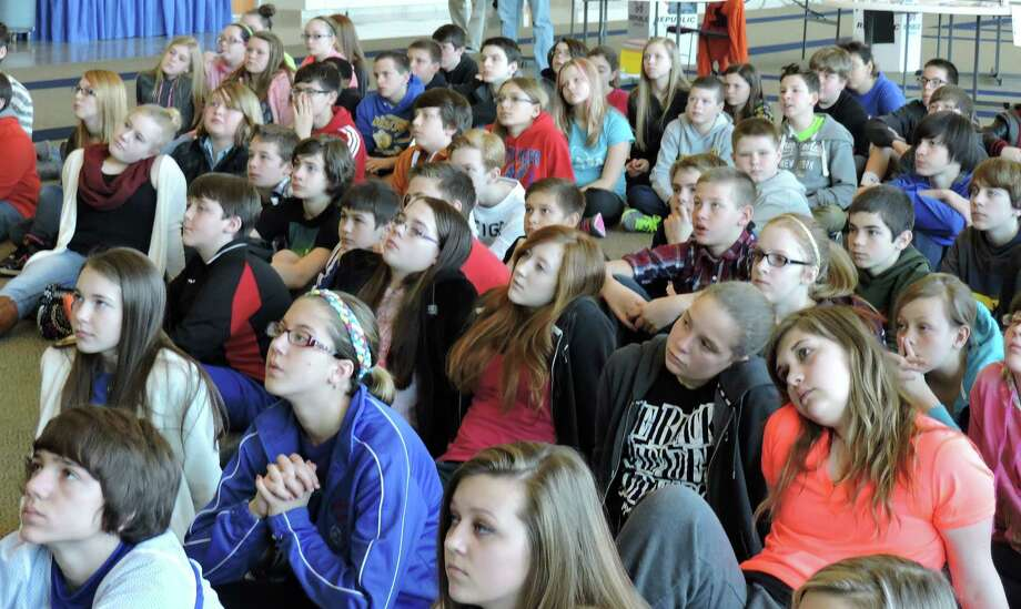 Middle school students sit as they watch the launch of four devices into space Friday, March 13, 2015, at the Robert H. Mollohan Research Center, in Fairmont, W.V. (AP Photo/Times West Virginian, Richard Babich) Photo: AP / Times-West Virginian