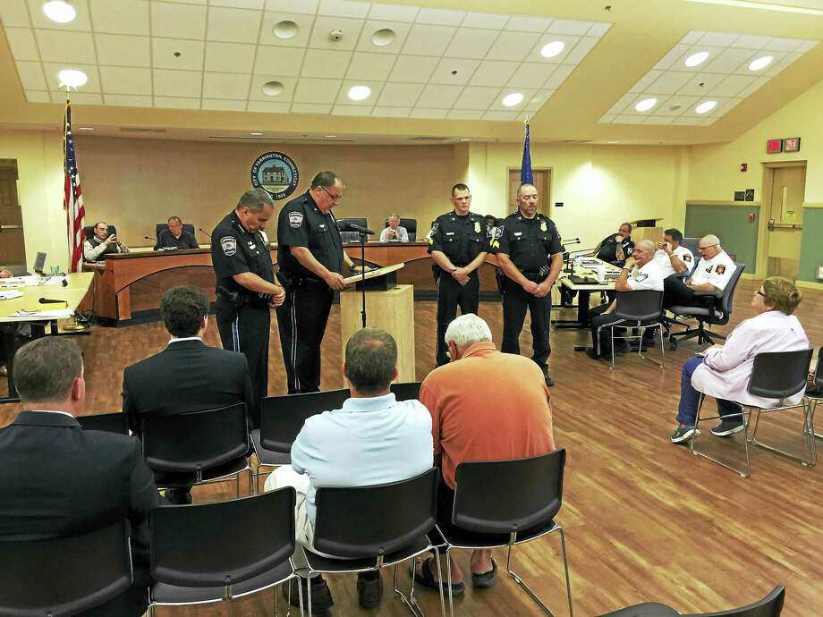 PHOTO BY BEN LAMBERTSgt. Brett Johnson and Sgt. Richard Dowd of the Torrington police department were presented with exceptional duty medals Wednesday for their efforts during an armed standoff last July. Photo: Journal Register Co.