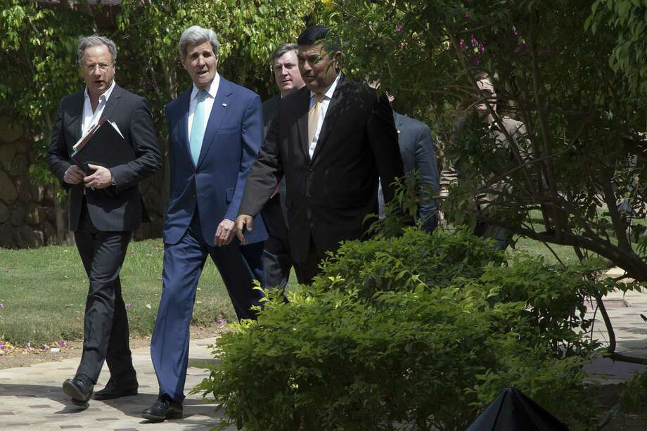 """U.S. Secretary of State John Kerry, second left, arrives for a meeting with Bahrain's king in Sharm el-Sheikh, Egypt, Saturday, March 14, 2015. At a news conference, Kerry delivered a highly cautious assessment ahead of the next round of nuclear talks with Iran, citing """"important gaps"""" in the way of a deal before an end of March deadline. He spoke Saturday in the Egyptian resort, where he attended an economic conference. (AP Photo/Brian Snyder, Pool) Photo: AP / POOL Reuters"""