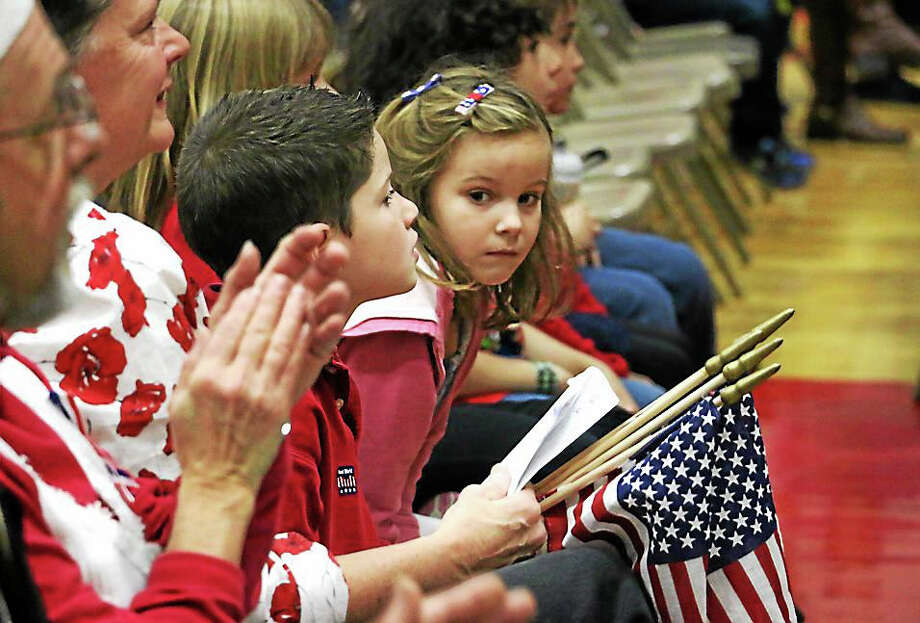 Students and staff at Botelle Elementary School in Norfolk hold an assembly in honor of veterans Wednesday morning. Photo: Photo By John Fitts — Register Citizen