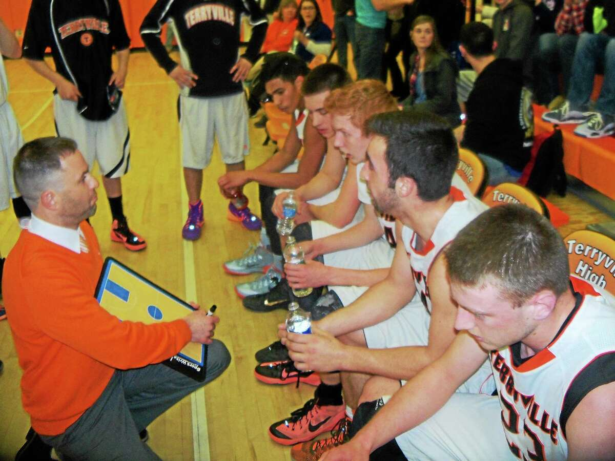 Peter Wallace - Register Citizen Terryville coach Mark Fowler lays out the plan for his starters in their 68-50 Class S round-two win over North Branford Thursday night at Terryville High School.