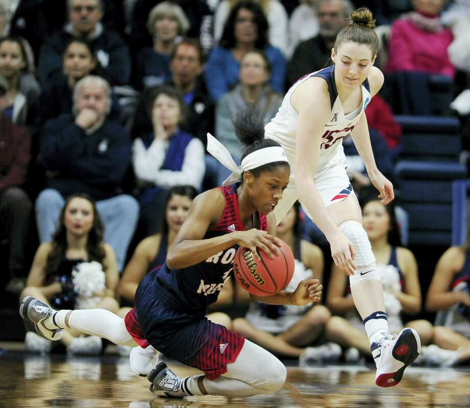 Robert Morris' Jocelynne Jones, left, falls to the court as UConn's Katie Lou Samuelson, right, defends during Saturday's NCAA tournament first-round game in Storrs. Photo: Jessica Hill — The Associated Press  / FR125654 AP