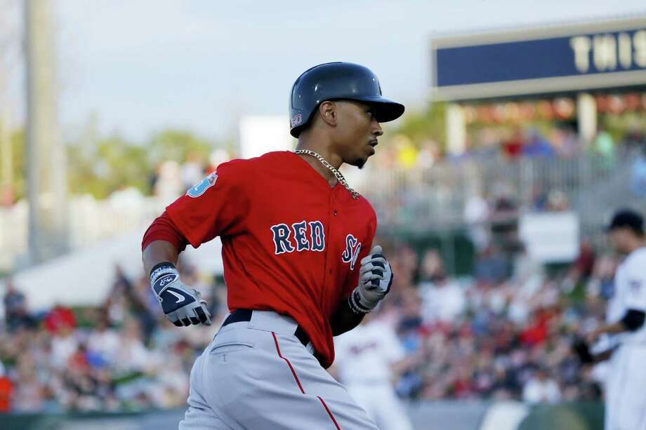 Mookie Betts, shown here rounding the bases earlier this spring training, hit his fourth spring training home run in Saturday's win over the Cardinals. Photo: The Associated Press File Photo  / AP