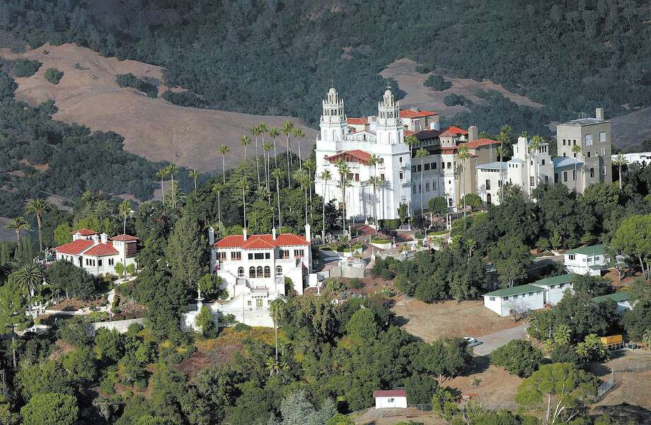 """FILE - This Oct. 23, 2006, file photo, shows """"La Cuesta Encantada,"""" The Enchanted Hill, the legendary home now best known as Hearst Castle, built by publishing tycoon William Randolph Hearst in San Simeon, Calif. The acclaimed film """"Citizen Kane"""" will be shown at Hearst Castle. The 1941 film, in part based on Hearst's life, so infuriated Hearst that he sought to derail the movie, which portrayed the rise and fall of an obsessively controlling character. (AP Photo/The Tribune, Joe Johnston, File) Photo: AP / The Tribune"""