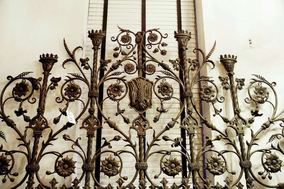 In this Tuesday, March 10, 2015 photo, a section of the St. Patrickís Cathedral Baptistery gates is part of a collection of historic artifacts at Urban Archeology in New York. The former salvage company that years ago switched to the manufacture of tile, lighting and bathroom accessories based on iconic designs, is auctioning off approximately 6,000 artifacts saved from destruction, nearly its entire salvage inventory. (AP Photo/Mark Lennihan) Photo: AP / AP