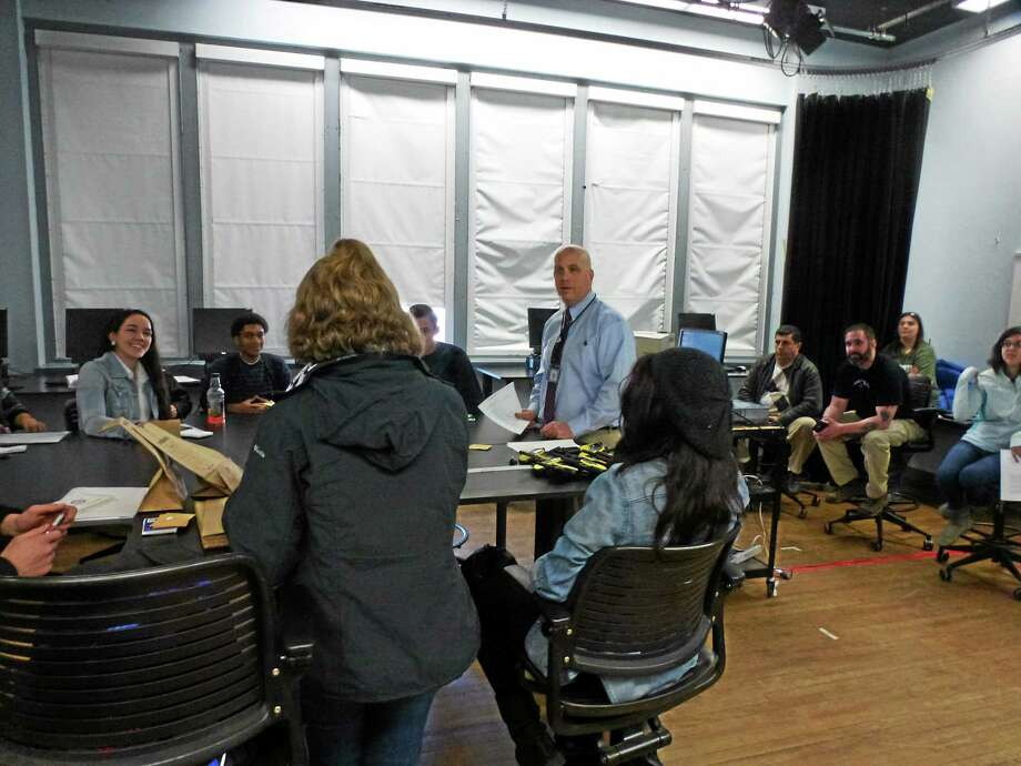Northwest Connecticut Community College Professor Michael Emanuel speaks with high school students following a mock crime scene event. Photo: Ryan Flynn — Register Citizen