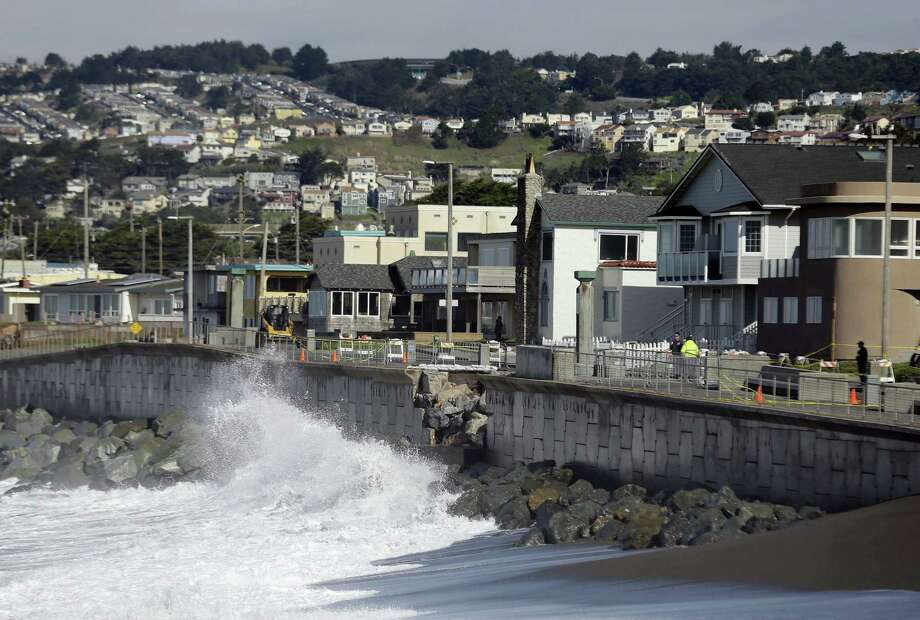 Waves crash near a damaged section of seawall in Pacifica, Calif., in January. Photo: Eric Risberg — The Associated Press  / AP