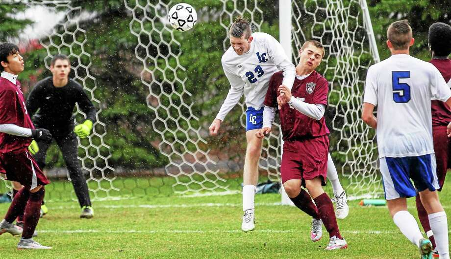 Litchfield's Ryan O'Neill heads the ball in his team's win over Windsor Locks Tuesday afternoon at Litchfield High School. Photo: Photo By Marianne Killackey -- The Register Citizen  / 2015
