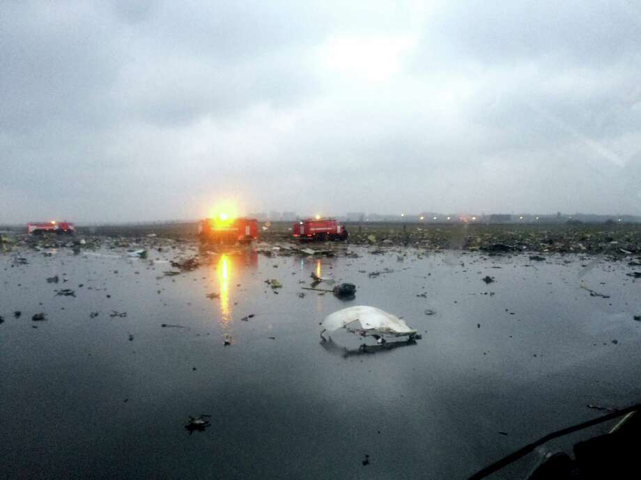 In this photo provided by vk.com/rostovnadonu, Russian emergency fire trucks patrol amongst the wreckage of the plane crash, at the Rostov-on-Don airport, about 950 kilometers (600 miles) south of Moscow, Russia Saturday, March 19, 2016. A Dubai airliner with 62 people on board nosedived and exploded in a giant fireball early Saturday while trying to land in strong winds in the southern Russian city of Rostov-on-Don, killing all aboard, officials said. Photo: Vk.com/rostovnadonu Group Via AP / https://vk.com/rostovnadonu