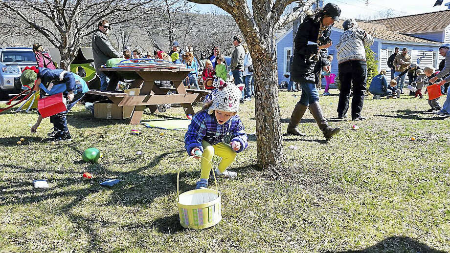 About 50 children searched for approximately 1,000 hidden plastic Easter Eggs containing candy and decals during the annual Easter Egg Hunt on the lawn near Rose's Kitchen at 1 Riverton Road in Riverton Saturday afternoon. Photo: N.F. Ambery —  The Register Citizen