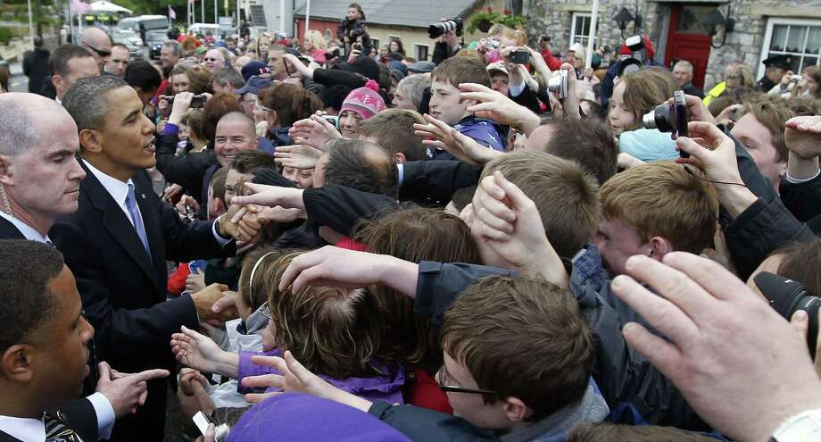 In this May 23, 2011 photo, President Barack Obama greets local residents in Moneygall, Ireland, the ancestral homeland of his great-great-great grandfather. Mark Connolly, the second-in-command on President Barack Obama's security detail, is at far left. Homeland Security is investigating two senior Secret Service agents accused of crashing a car into a White House security barrier, an agency spokesman says. Photo: AP Photo/Charles Dharapak  / AP