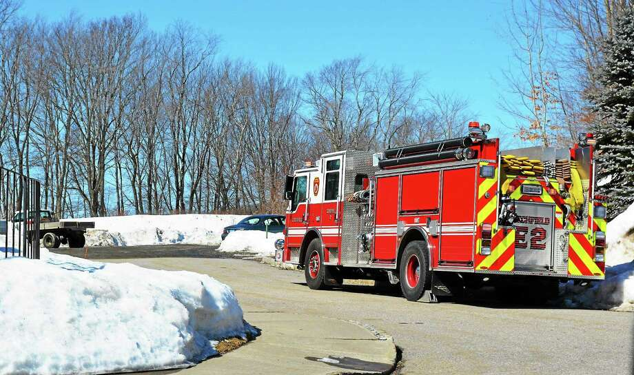 Firefighters from East Litchfield and Northfield responded to the Hunter's Chase Litchfield late Thursday morning after a 1,000 gallon propane tank began leaking. The tank was reportedly hit by a forklift. Photo: Amanda Webster — Register Citizen