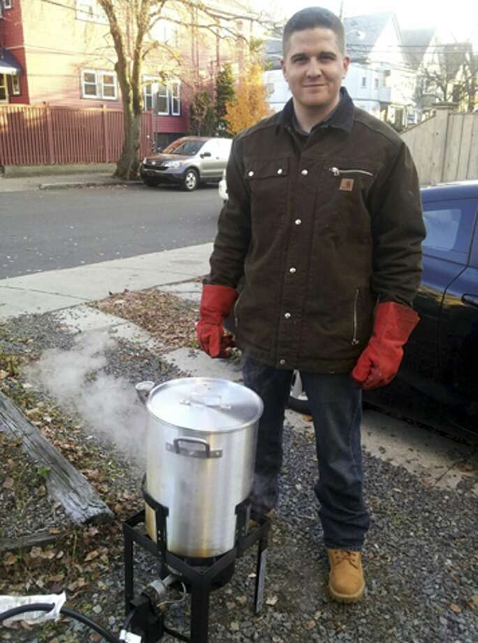 "FILE - In this November 2012 file photo provided by Nicole Lynch, her brother, Sean Collier, stands in his driveway in Somerville, Mass., frying a turkey for his annual kickball Thanksgiving gathering. Collier, a Massachusetts Institute of Technology police officer, was shot to death on the school campus in Cambridge, Mass., on April 18, 2013, three days after the Boston Marathon bombings. During testimony Wednesday, March 11, 2015, in the federal death penalty trial in Boston of Dzhokhar Tsarnaev, MIT Police Chief John DiFava testified he told Collier to ""be safe"" about an hour before he was shot dead. Prosecutors said the Tsarnaev brothers killed Collier during an unsuccessful attempt to steal his gun. Dzhokhar Tsarnaev's lawyer said during opening statements that it was Tamerlan Tsarnaev who shot Collier. Photo: (AP Photo/Nicole Lynch, File) / Nicole Lynch"