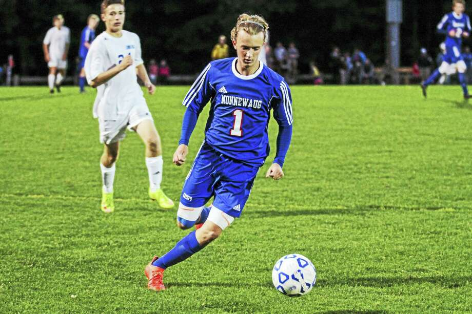 Photo by Marianne Killackey Nonnewaug's Nate Firlings scored both goals for the Chiefs in their win over Lewis Mills at Nassahegan Field Thursday night. Photo: Journal Register Co. / 2015