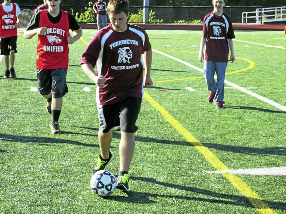 "Torrington's Adam Roy bears down for a goal at an NVL Unified Sports soccer game at Torrington High School Thursday afternoon. Seven NVL schools and well over 100 kids and adults took part in the tournament that Torrington Athletic Director Mike McKenna called ""the best we've had so far"" in the league's ongoing Unified Sports program. Photo: Photo By Peter Wallace"