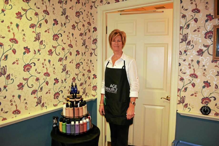 New owner Jennifer Tyrrell stands inside the Fifty Shades of Grey Hair Salon. Photo: Amanda Webster — The Register Citizen